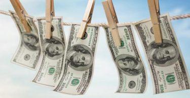 بحث عن الآثار السلبية الناتجة عن غسيل الاموال